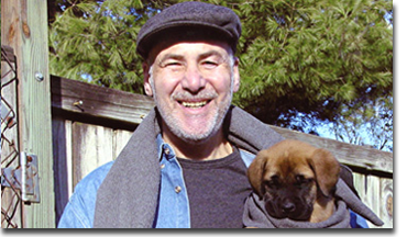 Michael Quattrochi 'Uncle Mikey' is recognized as a pioneer in the field of training young puppies.